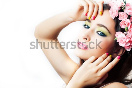 young pretty asian woman with flower orchid close up isolated Stock photo © iordani