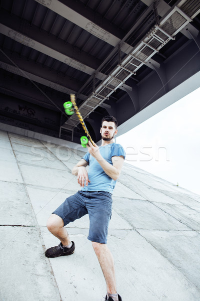 young handsome real hipsrter guy bearded staying under the bridg Stock photo © iordani