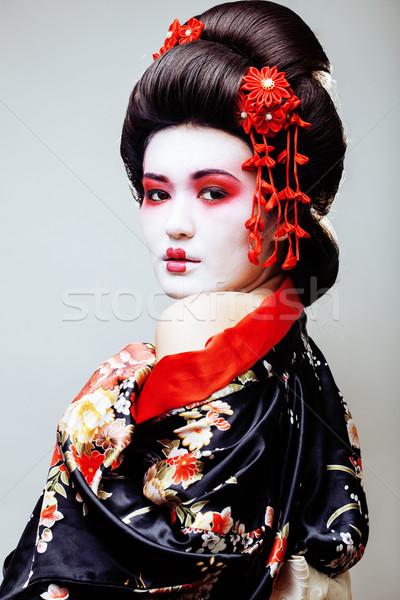 Jovem bastante gueixa preto quimono sakura Foto stock © iordani