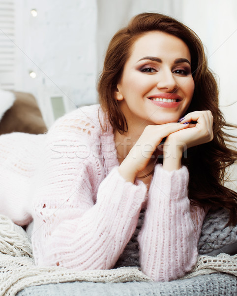 young pretty brunette girl laying in cozy bed with coffee wearing wool winter sweater happy smiling, Stock photo © iordani