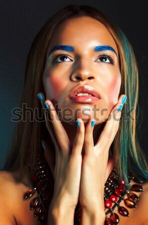 beauty bright african woman with creative make up, shawl on head like cubian Stock photo © iordani