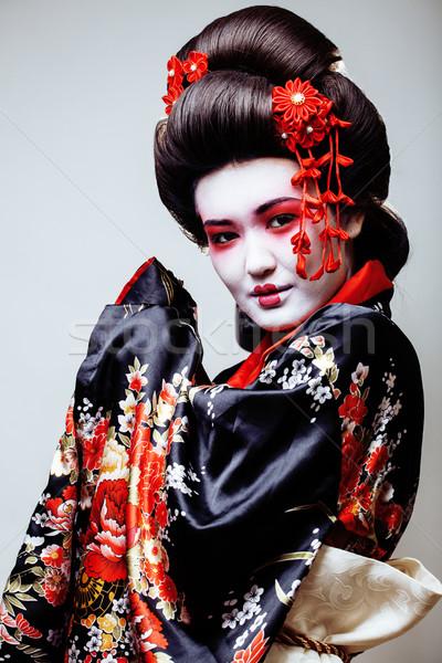 young pretty geisha in kimono on white background Stock photo © iordani
