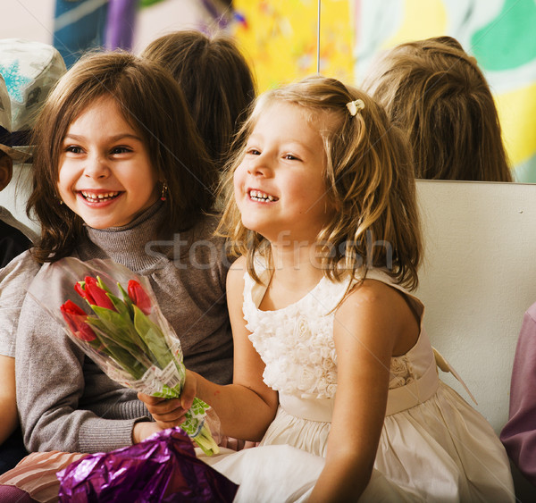 three little diverse girls at birthday party having fun Stock photo © iordani