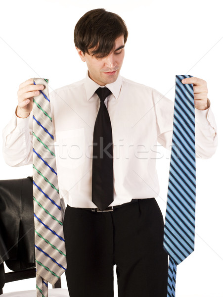 young brunette handsome guy having choice between two ties isolated on white background, lifestyle b Stock photo © iordani