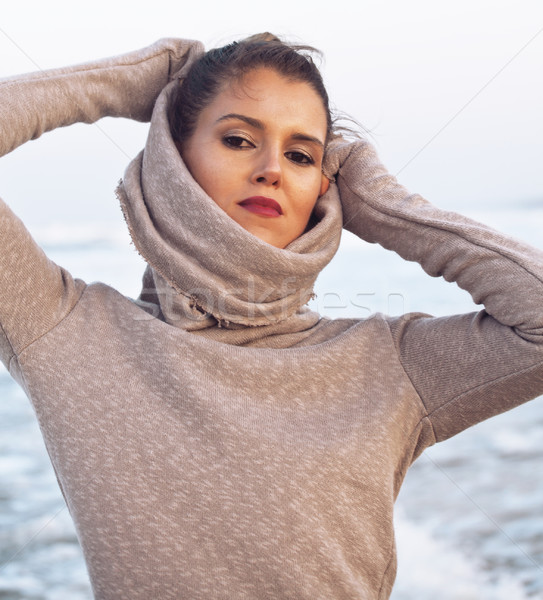 young pretty woman in sweater at seacoast walking relaxing Stock photo © iordani