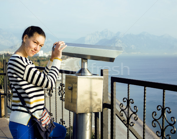 young woman looking through telescope at sea viewpoint in Atatur Stock photo © iordani