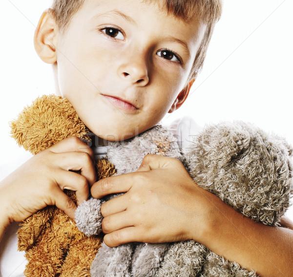 Kicsi aranyos fiú sok plüssmackók ölel Stock fotó © iordani