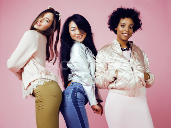 three different nation girls with diversuty in skin, hair. Asian, scandinavian, african american che Stock photo © iordani