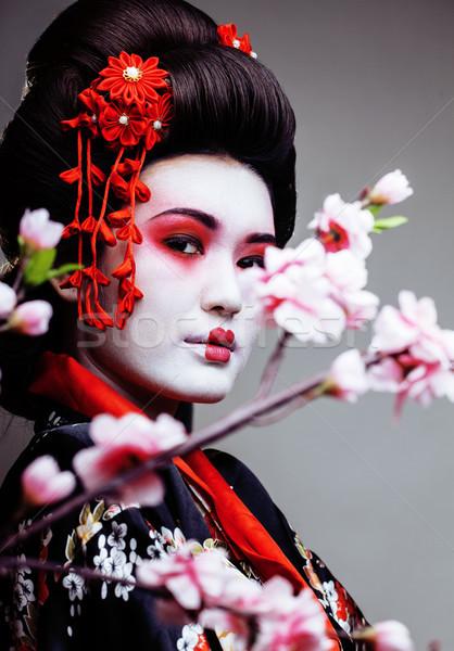 Giovani bella geisha kimono sakura rosso Foto d'archivio © iordani