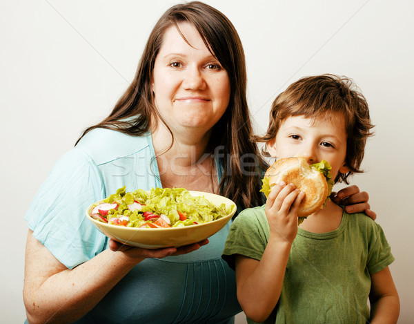 Stock photo: mature woman holding salad and little cute boy with hamburger te