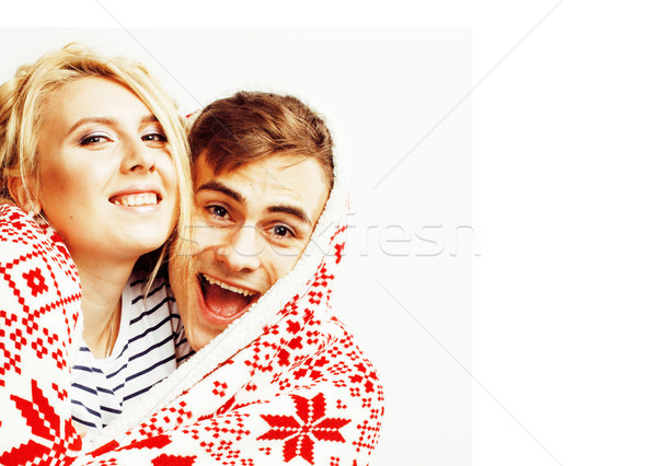 young pretty teenage couple at Christmas time warming in red dec Stock photo © iordani