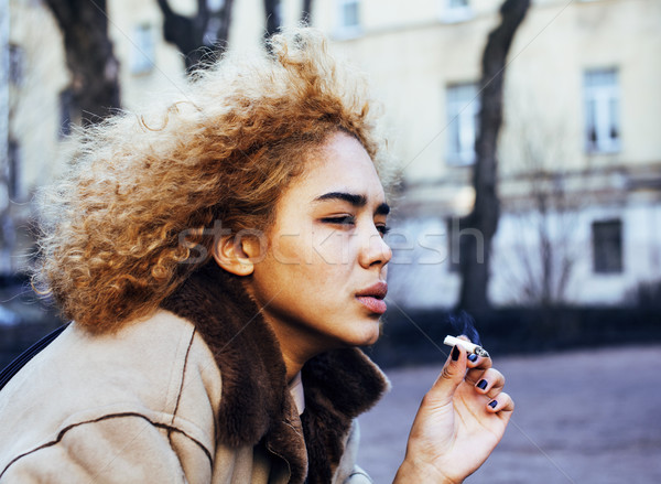 young pretty girl teenage outside smoking cigarette close up, lo Stock photo © iordani