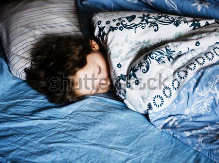 crying woman laying in bed, like prostitute Stock photo © iordani