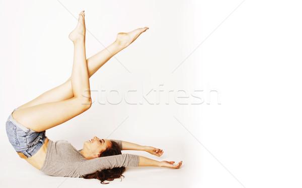 Genç güzel esmer kadın kafa topuk Stok fotoğraf © iordani