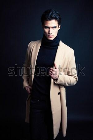 クール 本当の 若い男 コート 黒 ポーズ ストックフォト © iordani