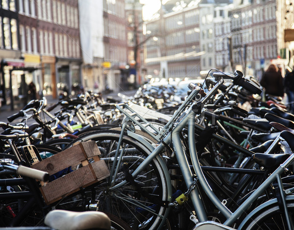 many bicycles on street of Amsterdam city, parking ideal traffic Stock photo © iordani