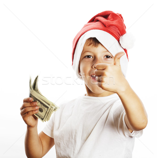 little cute boy in santas red hat isolated with cash american do Stock photo © iordani