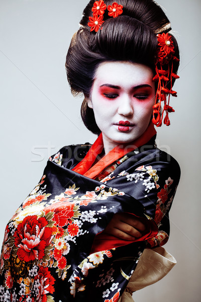 young pretty geisha in black kimono among sakura, asian ethno Stock photo © iordani