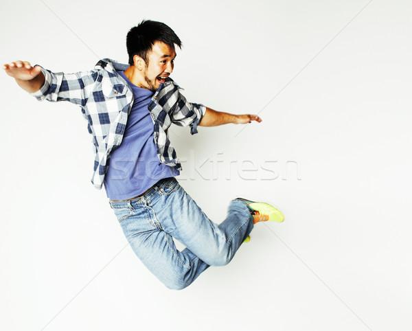 Stock fotó: Fiatal · csinos · ázsiai · férfi · ugrik · derűs