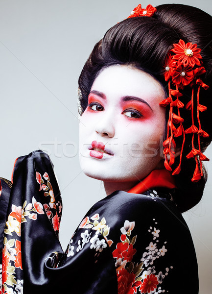 young pretty geisha in black kimono among sakura, asian ethno close up Stock photo © iordani