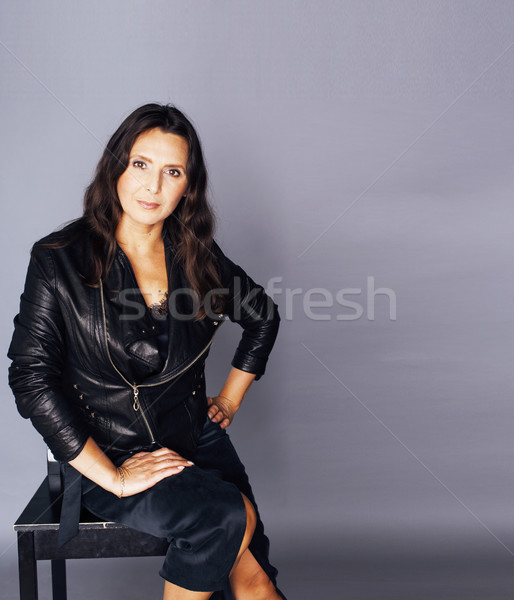 pretty brunette confident mature woman sitting on chair in studi Stock photo © iordani