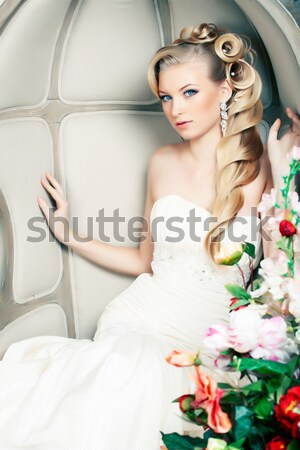 Stock photo: beauty young bride alone in luxury vintage interior with a lot o