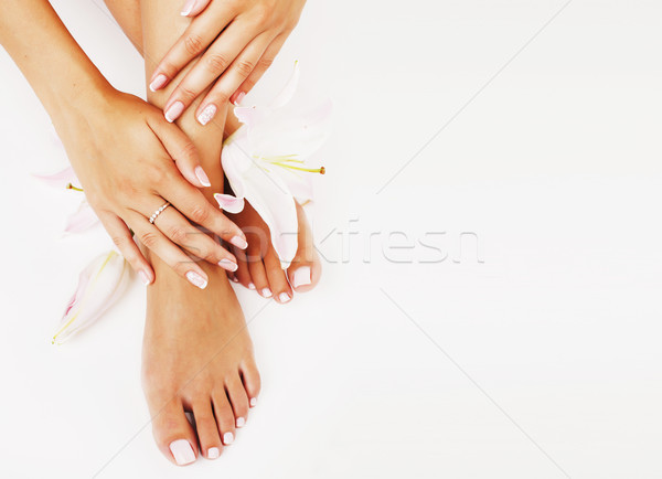 manicure pedicure with flower lily close up isolated on white perfect shape hands Stock photo © iordani