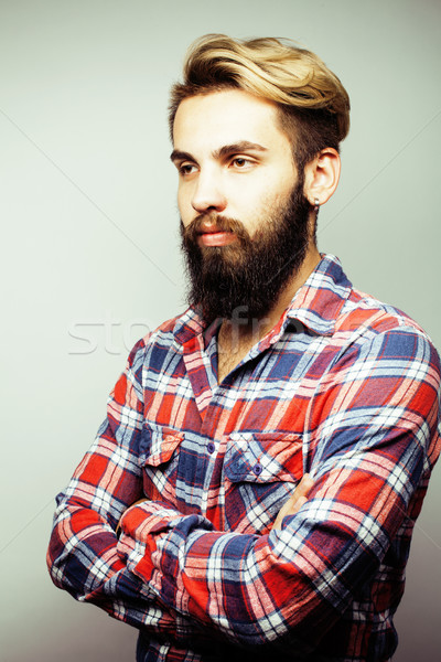 portrait of young bearded hipster guy smiling on white background close up, brutal man, lifestyle pe Stock photo © iordani