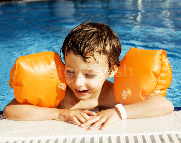 little cute real boy in swimming pool close up smiling, lifestyle vacations people concept Stock photo © iordani
