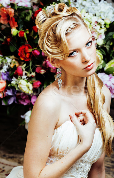 Stock photo: beauty young woman bride alone in luxury vintage interior with a lot of flowers close up