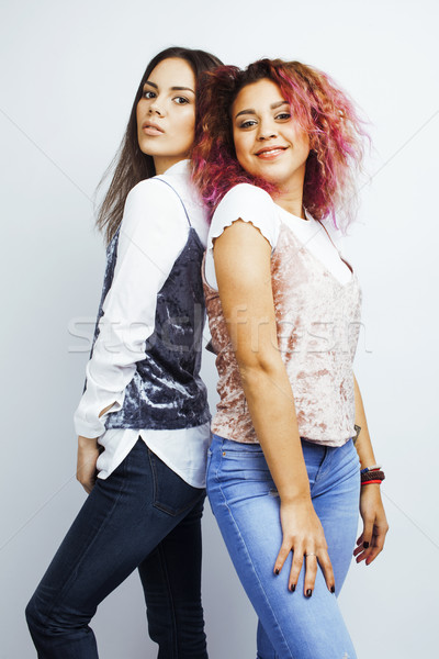 lifestyle people concept: two pretty stylish modern hipster teen girl having fun together, diverse n Stock photo © iordani