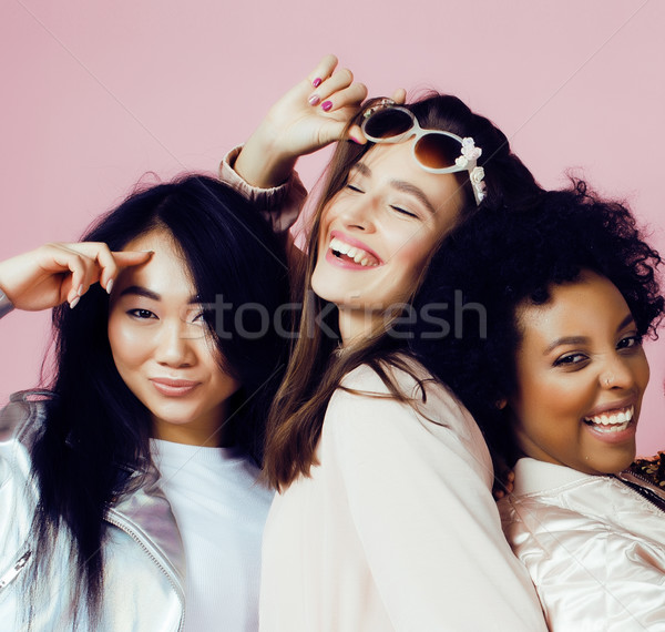different nation girls with diversuty in skin, hair. Asian, scandinavian, african american cheerful  Stock photo © iordani