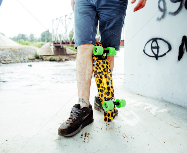 young handsome real hipsrter guy bearded staying under the bridge extreme with leopard skateboard, l Stock photo © iordani