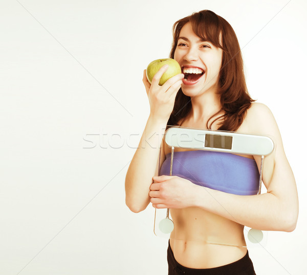 portrait of young smiling girl with green apple and scales Stock photo © iordani