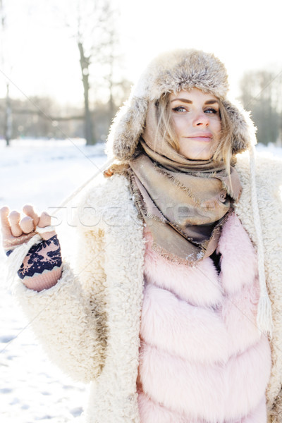 young pretty teenage hipster girl outdoor in winter snow park having fun drinking coffee, warming up Stock photo © iordani
