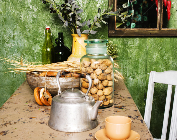 Stock photo: country kitchen with green walls and wood table, rural look