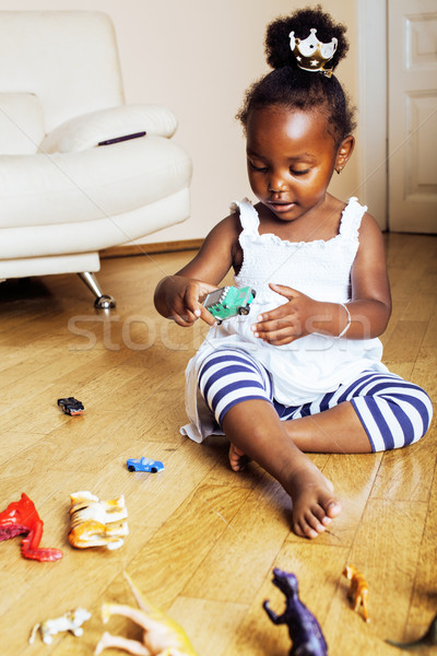 Stock photo: little cute african american girl playing with animal toys at ho