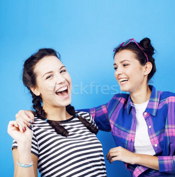 best friends teenage school girls together having fun, posing on blue background, besties happy smil Stock photo © iordani