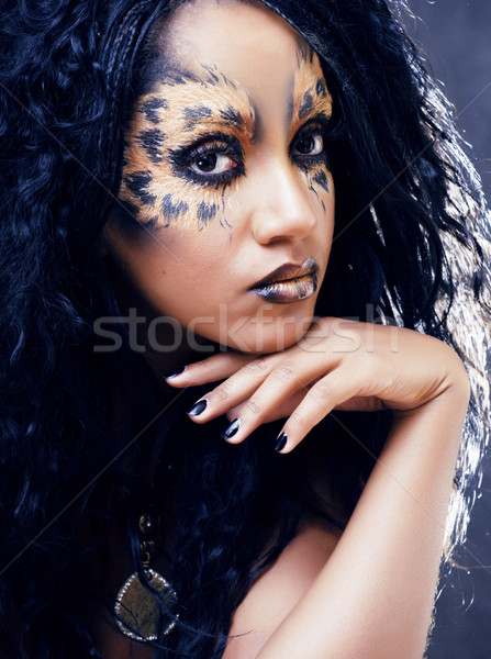 beauty afro girl with cat make up, creative leopard print Stock photo © iordani