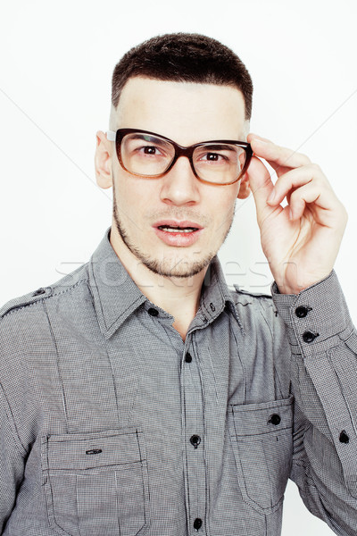 young handsome well-groomed guy posing emotional on white background, lifestyle people concept Stock photo © iordani