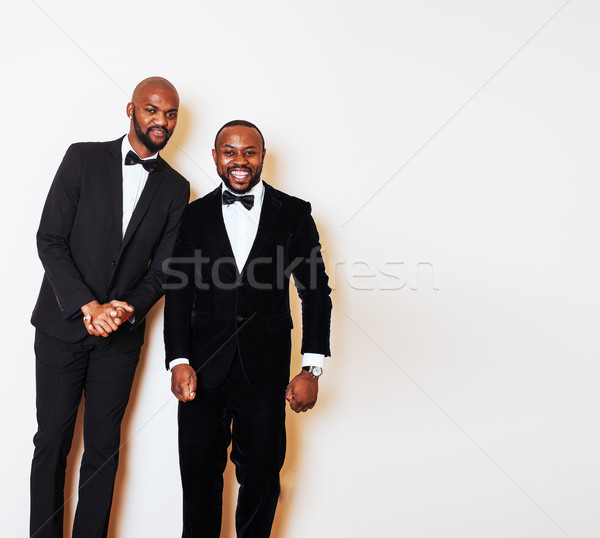 two afro-american businessmen in black suits emotional posing, g Stock photo © iordani