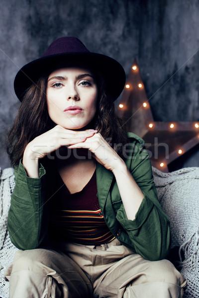 young pretty woman waiting alone in modern loft studio, fashion musician concept, lifestyle people Stock photo © iordani