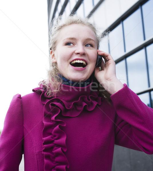 Bastante loiro mulher falante telefone Foto stock © iordani