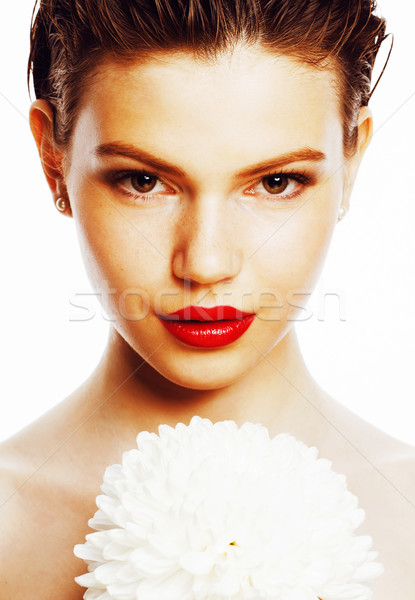 Stock photo: young brunette woman close up isolated on white with big flower, spa girl concept