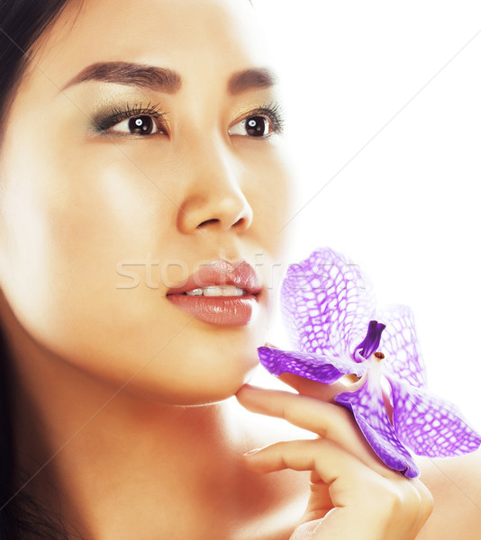 Stock photo: young pretty asian woman with flower orchid close up isolated sp