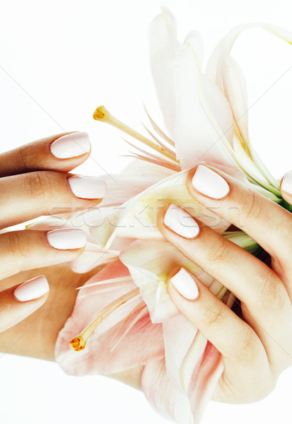 beauty delicate hands with manicure holding flower lily close up isolated on white, spa salon concep Stock photo © iordani