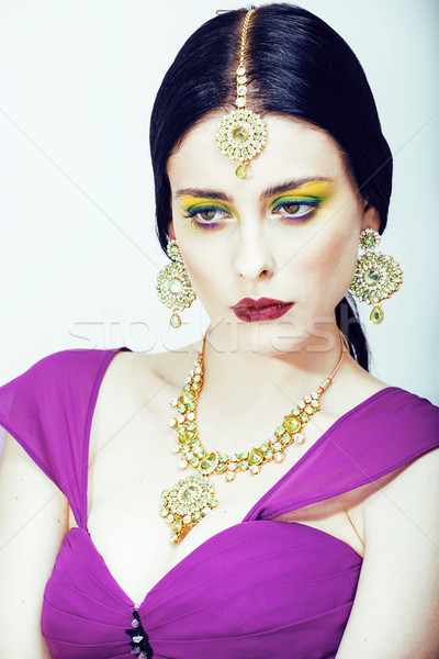Stock photo: young pretty caucasian woman like indian in ethnic jewelry close up on white, bridal makeup