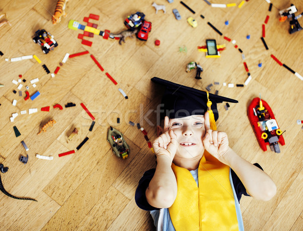 little cute preschooler boy among toys lego at home in graduate  Stock photo © iordani