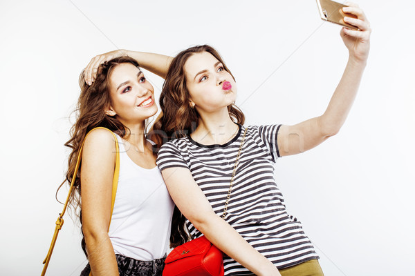 Stock photo: two best friends teenage girls together having fun, posing emotional on white background, besties ha