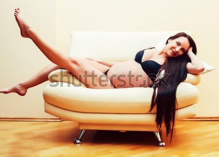 beauty yong brunette woman sitting near fireplace at home, winter warm evening in interior Stock photo © iordani